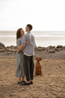 Young couple with dog at the beach - VPIF01517