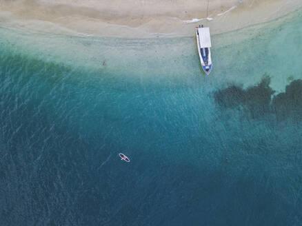 Drone shot of paddleboard on Gili-Air Island at Bali, Indonesia - KNTF03431