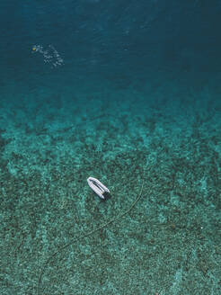 Aerial view of boat on sea at Gili-Air Island, Bali, Indonesia - KNTF03437
