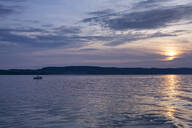 Scenic view of Lake Constance against moody sky at sunset, Überlingen, Germany - FCF01806