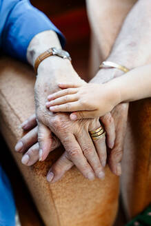 Elderly couple and baby's hand, generations together - GEMF03156