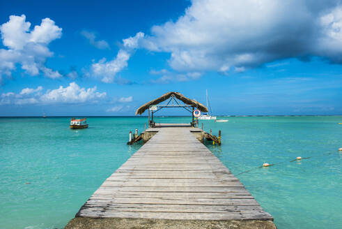 Diminishing perspective of pier over Caribbean sea at Pigeon Point beach, Tobago - RUNF03170