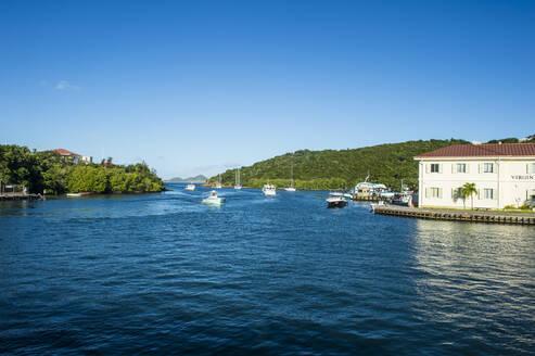 Boats on sea at Cruz bay against blue sky, Virgin Islands National Park, USA - RUNF03200
