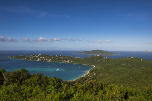 Drone shot of St. Thomas island against blue sky during sunny day, US Virgin Islands - RUNF03209