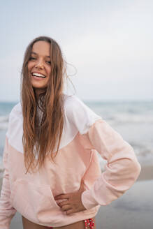 Portrait of happy young woman on the beach - DLTSF00155