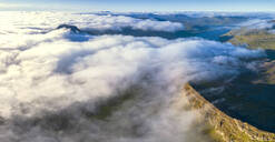 Aerial panoramic of clouds on the rocky peaks of Skaelingsfjall and Sornfelli mountains, Streymoy island, Faroe Islands, Denmark, Europe - RHPLF11614