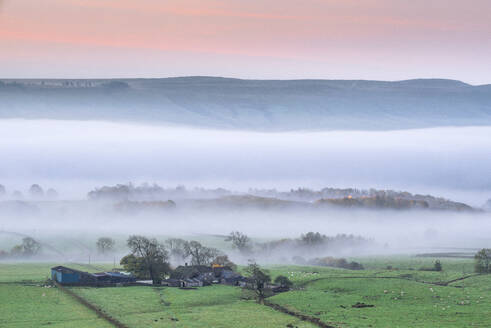 Mist rising over East Halton and Embsay in Lower Wharfedale, North Yorkshire, Yorkshire, England, United Kingdom, Europe - RHPLF11796