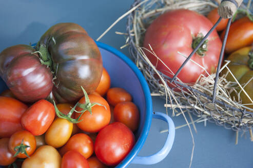High angle view of tomatoes in containers on table - GISF00467