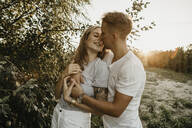 Portrait of young kissing couple - LHPF00854