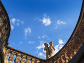 Low angle view of statues on retaining wall against blue sky at Dresden, Germany - LAF02376
