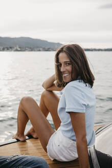 Portrait of smiling young woman on a boat - LHPF00941