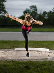 Femal shot-putter training with ball - STSF02257
