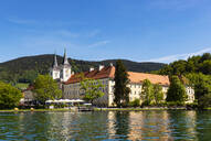 View of Tegernsee Abbey and St. Quirinus Church against blue sky during sunny day, Bavaria, Germany - LHF00721