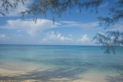Scenic view of Norman Saunders beach against blue sky at Grand Turk, Turks And Caicos Islands - RUNF03230