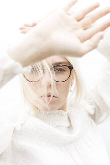 Portrait of blond young woman with glasses dressed in white - JESF00355