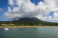 Scenic view of Nevis island against cloudy sky at Saint Kitts And Nevis, Caribbean - RUNF03247