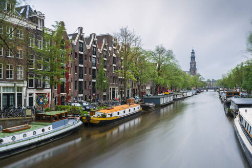 Netherlands, Amsterdam, Various boats moored along city canal - XCF00228
