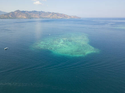 Aerial view of atoll at Gili-Air Island against sky, Bali, Indonesia - KNTF03510