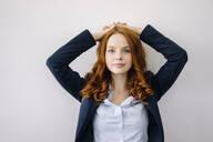 Portrait of redheaded businesswoman - KNSF06626