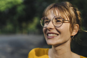 Portrait of smiling young woman with glasses - KNSF06695