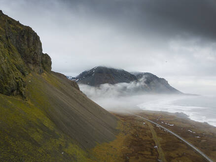 Iceland, Empty road between rough mountains and shore of Jokulsarlon - DAMF00069