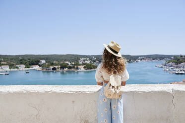 Rear view of young woman standing at view point, Menorca, Spain - IGGF01343
