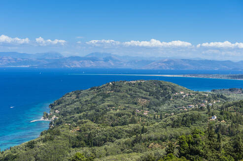 Aerial view of coastline against blue sky during sunny day, Corfu, Ionian islands, Greece - RUNF03324