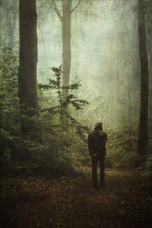 Man on forest path - DWIF01036