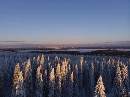Finland, Kuopio, aerial view of winter landscape at sunset - PSIF00322