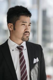 Portrait of confident young businessman - JPIF00201
