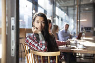 Portrait of woman with colleagues in a cafe - FKF03648