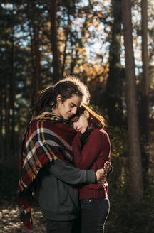 Young couple in love in forest - DAMF00119