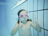 Underwater portrait of a girl with thumbs up - XCF00257