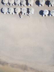 Woman lying on sun lounger at the beach, Gili Air, Gili Islands, Indonesia - KNTF03585