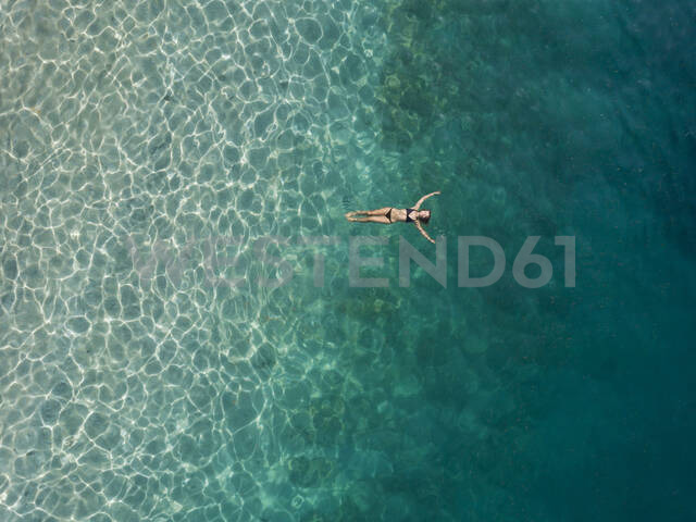 Woman floating in the sea, Gili Air, Gili Islands, Indonesia - KNTF03597 - Konstantin Trubavin/Westend61