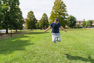 Man skipping rope in a park - MGIF00739