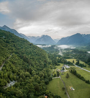 Aerial view of misty Soca valley in Slovenia - AAEF03882