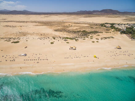 Aerial view of Corralejo's Big Beaches with turquoise sea in Fuerteventura, Canary Islands. - AAEF04011