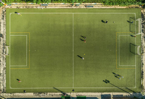 Aerial view of a football training on synthetic surface football pitch on a summer day. - AAEF04236