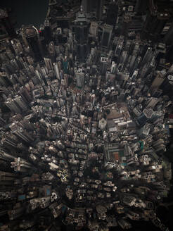 Moody aerial view of downtown buildings in business district in Hong Kong, China. - AAEF04458