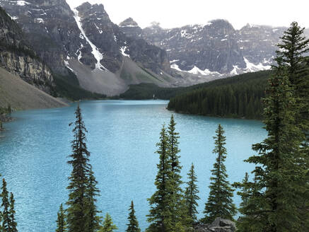 Foggy morning view of Moraine Lake and surrounding mountains. - CAVF63348