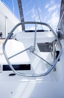 Aluminium steering wheel in a pilot house of a cruising catamaran - CAVF64101