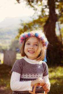 Portrait of a smiling young girl with hair wreath outdoors - XCF00262