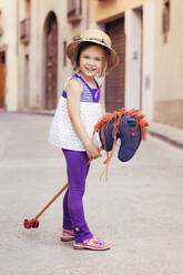 Portrait of little girl with hobby horse - XCF00267