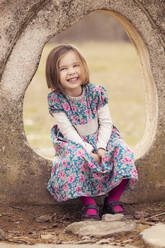 Portrait of laughing little girl wearing dress with floral design - XCF00270
