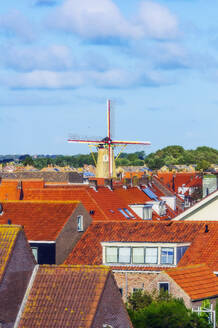 Netherlands, Zeeland, Westkapelle, townscape with windmill  - THAF02604