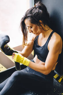 Female boxer resting after boxing training - CJMF00033