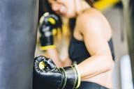 Female boxer training in gym - CJMF00039