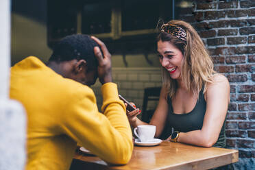 Couple having fun in a coffee shop - CJMF00043