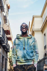 Portrait of happy young man in the city - CJMF00058